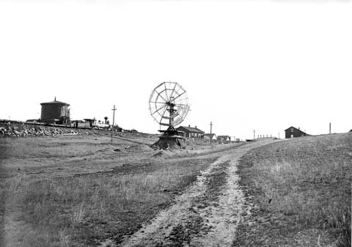 Sherman, ca.1870. The water tower is on the left side of the image, directly beyond the windmill is Sherman Station. Wyoming State Archives, Department of State Parks and Cultural Resources.